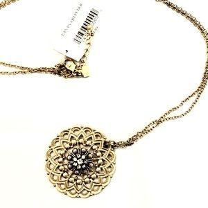 BANANA REPUBLIC antiqued tribal dual tone pendant